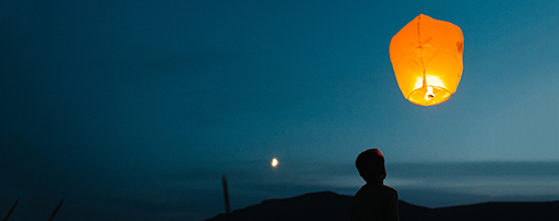 Lantern and man in moon light at night