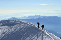 Two mountaineers reach the summit