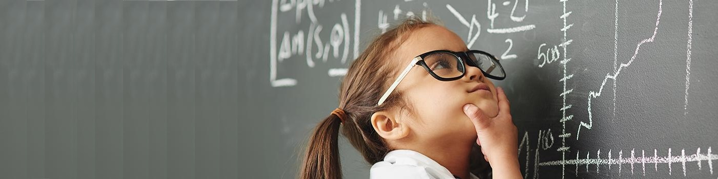 Girl thinking in front of blackboard