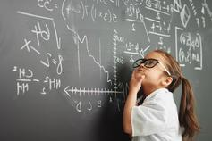 Increasing numeracy skills and confidence across the UK - Photo of girl looking at formulas on a blackboard