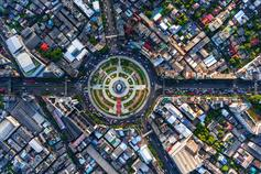 Aerial view road roundabout with car lots of city