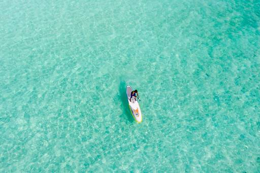 Sea view from the sky, Man doing stand up paddling