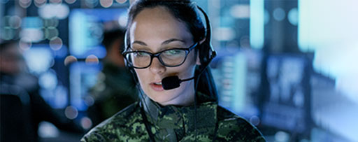 Female Military gives instructions into Headset