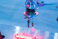 Red laser light on blue semiconductor diodes
