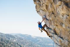 Strategy, operational performance & business transformation (pdf) - mountaineer climbing a rock