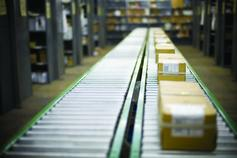 Boxes and parcels on conveyor belt