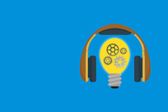 headphones and light bulb on light blue background