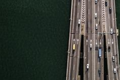 Top view of a highway with cars on sea