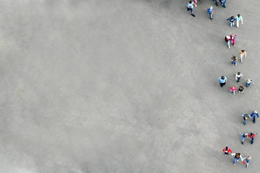 Aerial view of people standing in a grey concrete square