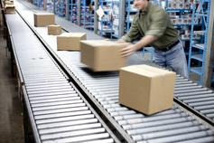 Man working with boxes on conveyer belt
