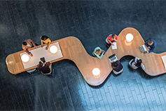 Overhead view of business meeting on a curvy table