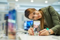 Woman taking selfie in store