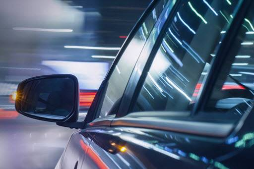 car-side-mirror-at-night-with-light