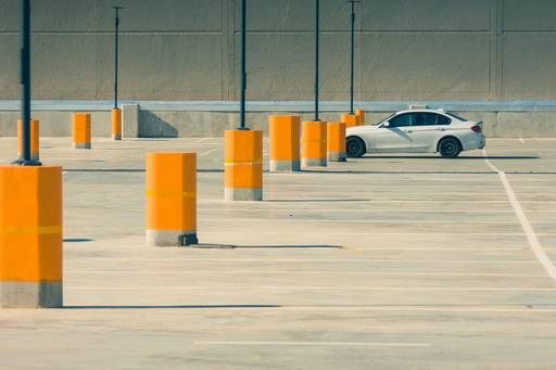 Single car parked in an empty carpark