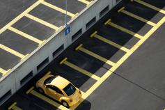 Yellow car in parking lot
