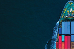 Top view of ship in sea carrying goods and huge containers