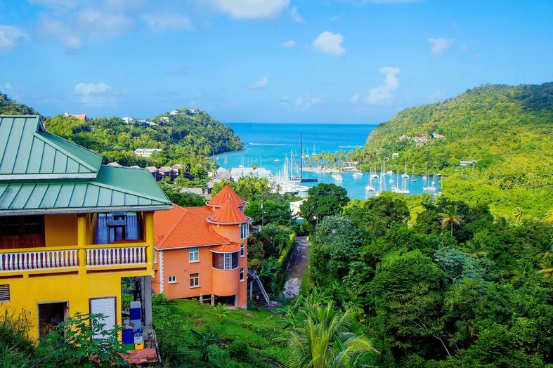Colourful houses and boats in harbour Saint Lucia