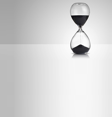 Hourglass on plain background