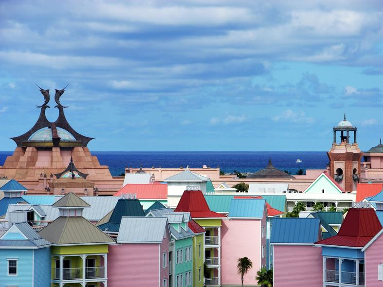 Colourful houses blue water and sky