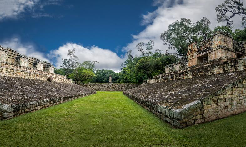 Fort view with green grass and trees against blue sky, Americas Guide Honduras