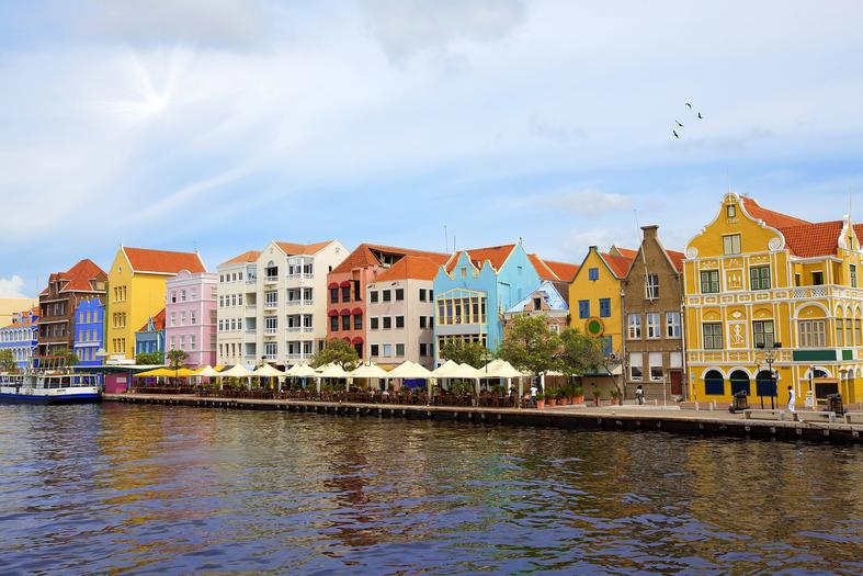 Multi colour buildings across lake in Curacao