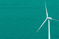 Wind turbine in green sea