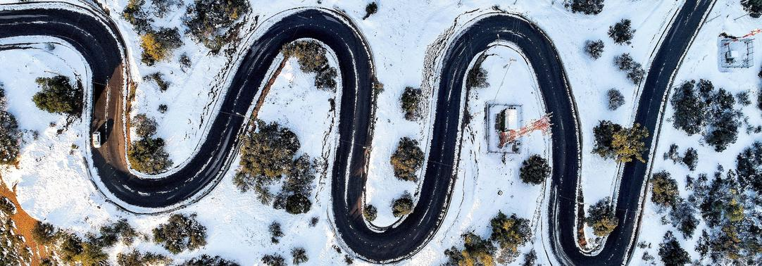 Aerial view of zigzag road over snow