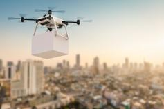 Optimising the supply chain through digital transformation - photo of a drone carrying a package