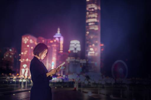 Woman working on tablet at night