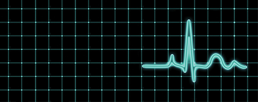 Green heart rate monitor lines on a grid with black background