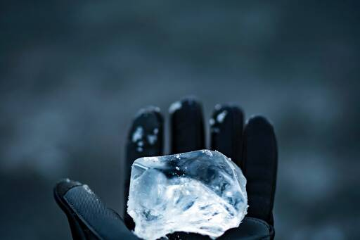 piece-of-ice-on-hand-wearing-black-gloves.jpg