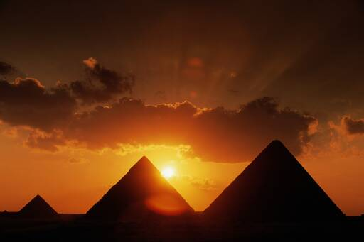 Rising sun behind the pyramids of Egypt