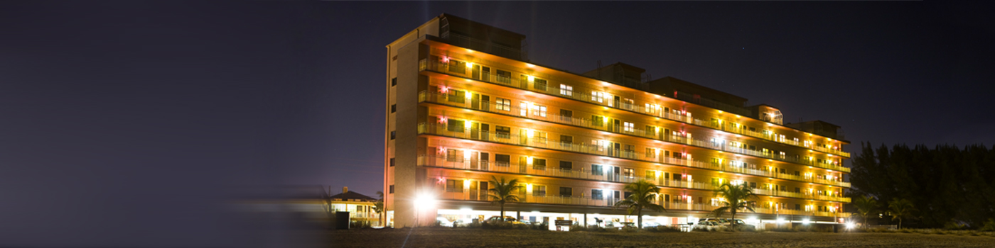 Night view of beachside hotel building lights