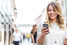 Smiling woman using an iPhone