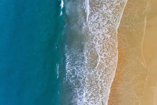 Revisiting diversified growth funds - Beach view with blue water