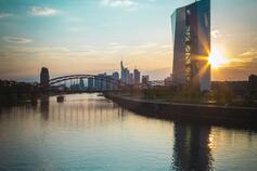City view with tall building in focus at river bank