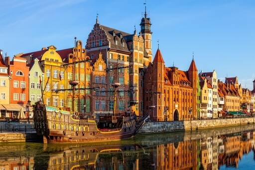 Huge ship in water along with multi coloured buildings Poland