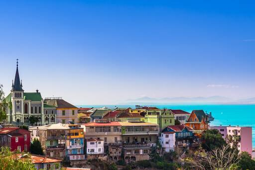 Colourful houses with sloping roofs near sea, Chile