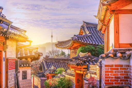Korean brick houses with wooden sloping roof during sunset