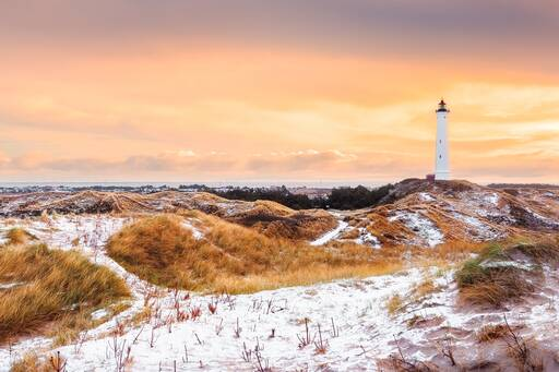 Light house in sand dunes during sunset, Denmark