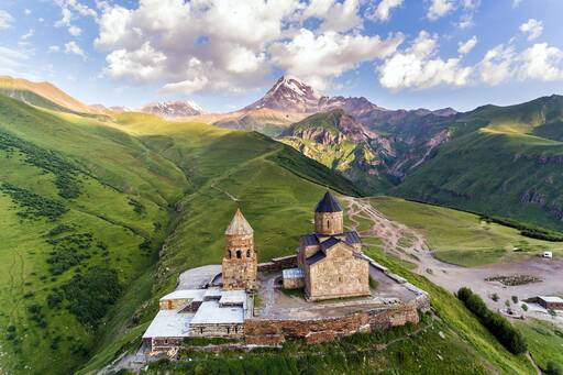 Trinity church in the middle of mountains covered with greenery,Georgia
