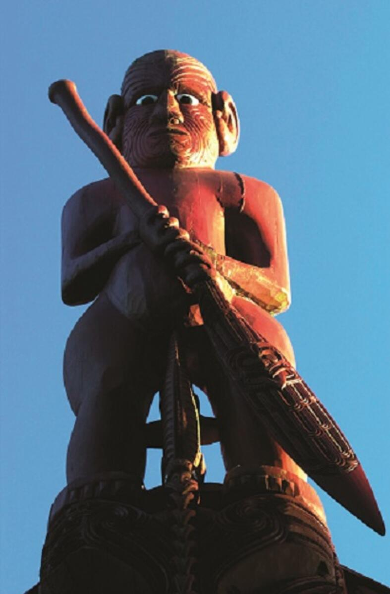 Traditional Maori carvings on a Waka boat