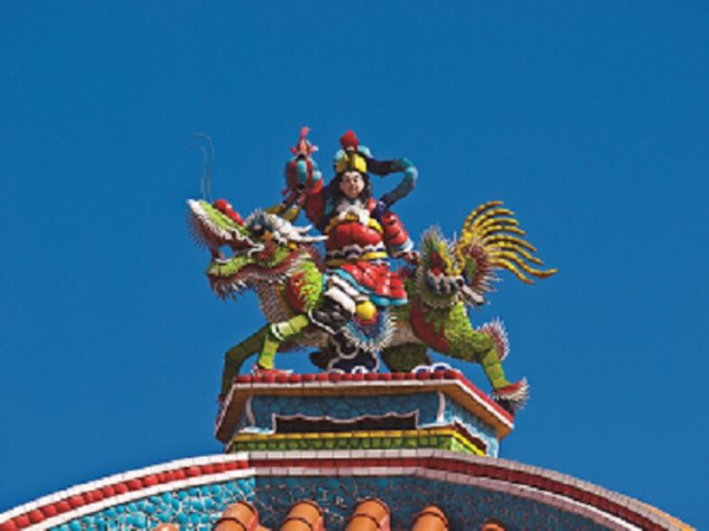 Ornate statue on a Colorful Buddhist temple