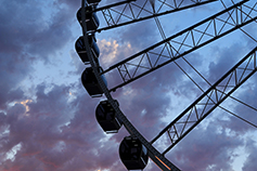Silhouette of Great Seattle Wheel under sunset sky, Seattle, Washington, United States