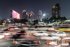 Rush hour captured with blurred motion in the heart of the business district of Jakarta on the gatot Subroto highway in Indonesia capital city at night