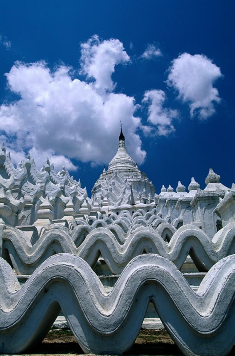 White temple with clouds behind