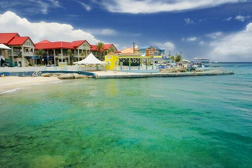 Cayman islands shore with bright colored buildings.