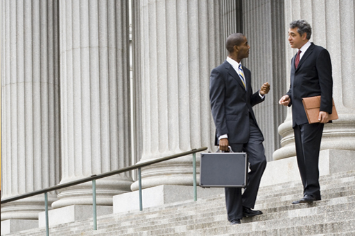 Two businessmen on stairs