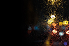 Bokeh effect photography of lights through water drops on window