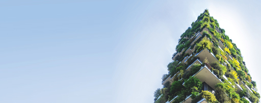 Building with vertical green plants and trees